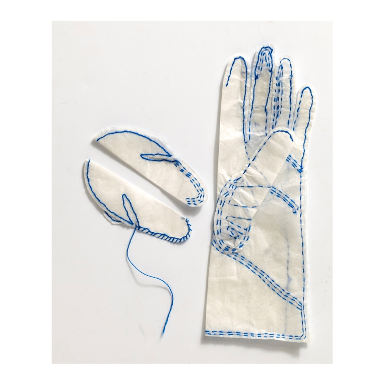 white-paper-glove-thumb-stitch-sample